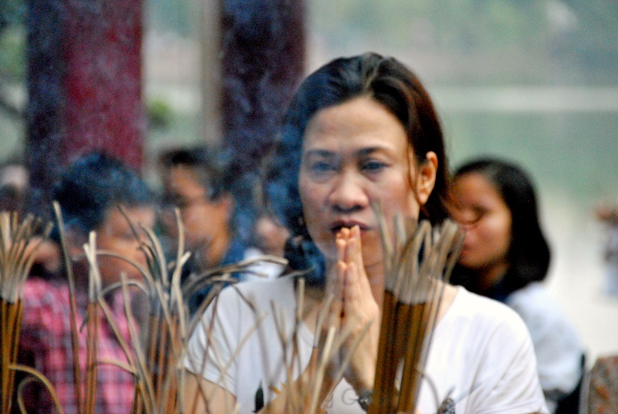 Vietnamiti in preghiera